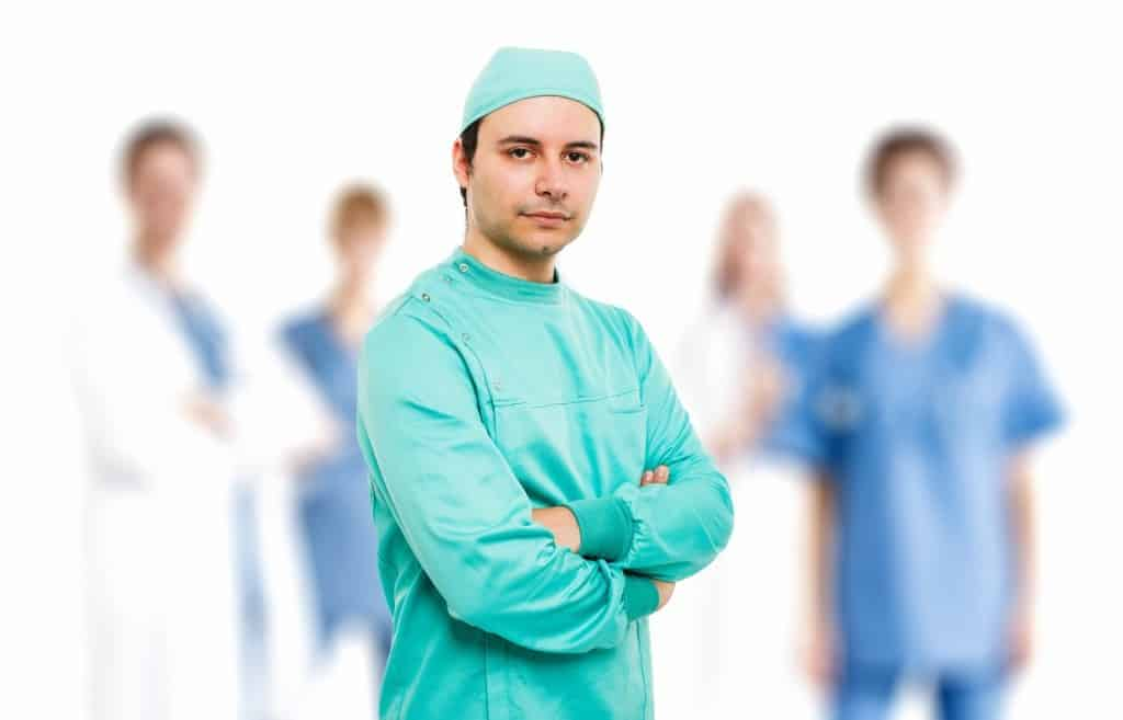 Surgeon in front of his team